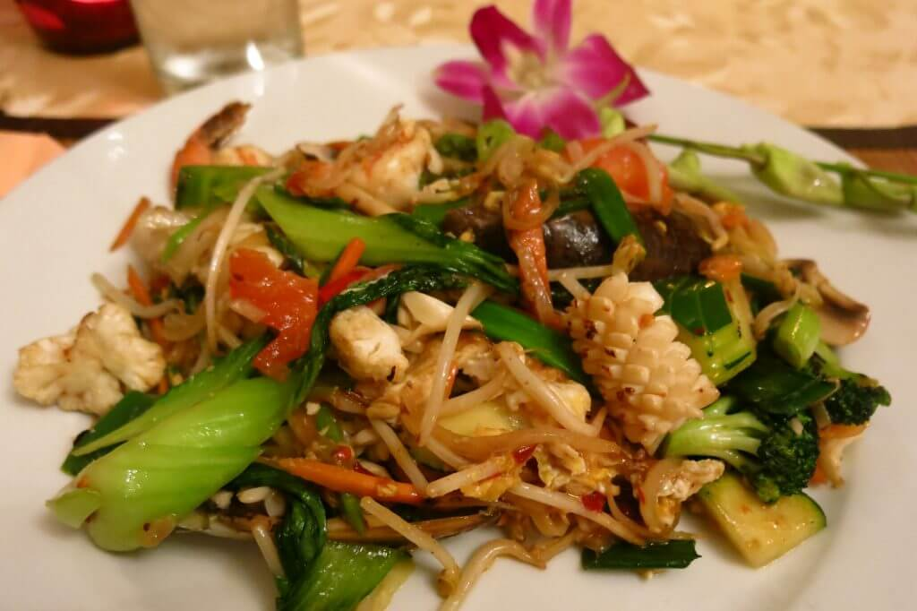 Fried rice noodles with a variety of vegetables and seafood (fresh mussels, prawns and calamari)