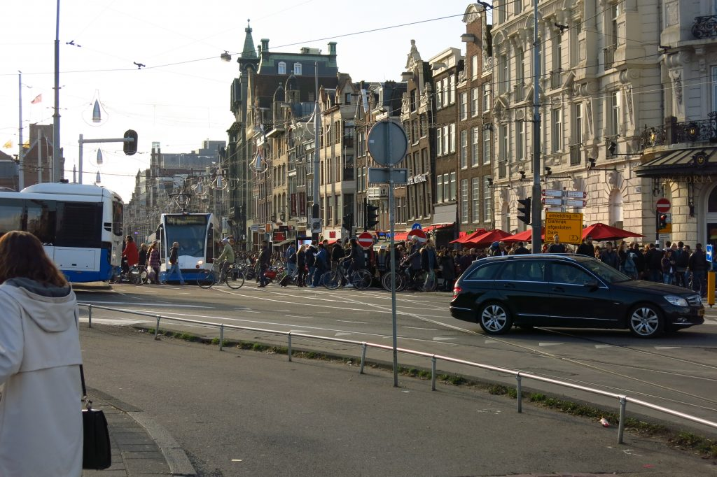 The intersection of Damrak & Prins Hendrikkadenear Amsterdam Centraal Station