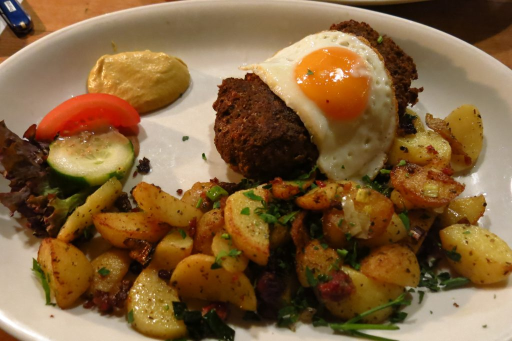 Potatoes with mustard, sunny-up egg and a fat meatball