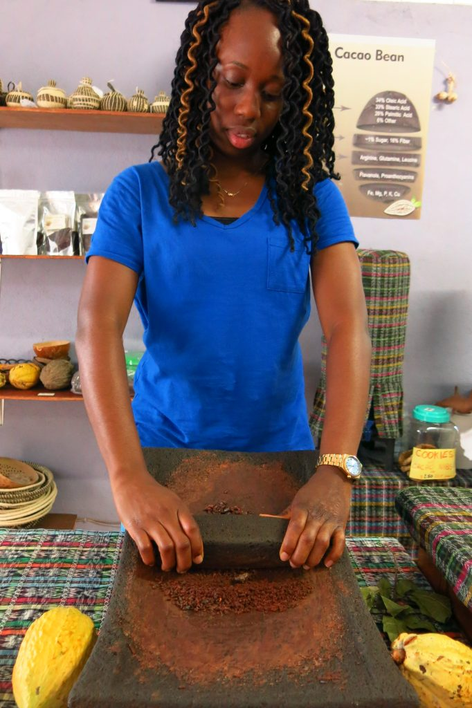 Grinding Raw Cacao Nibs on metate