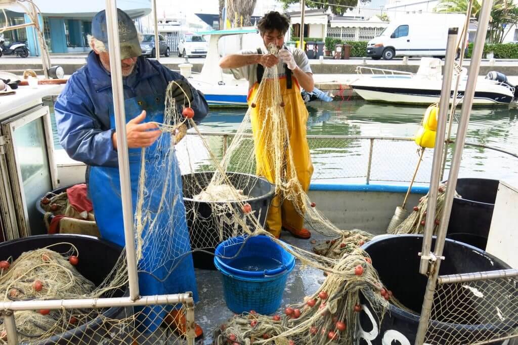 Fishermen at the pier in Viareggio, Italy